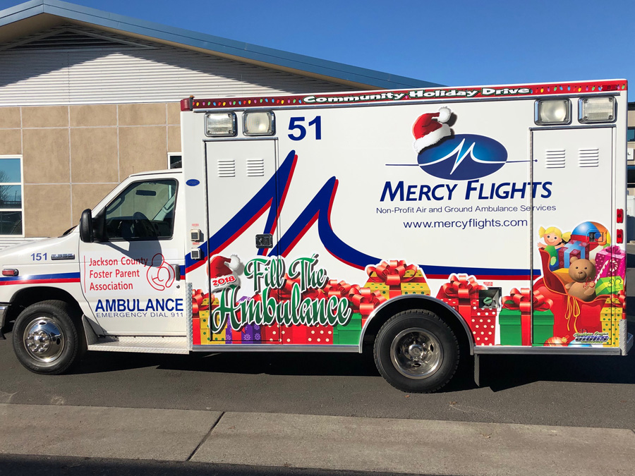 Mercy Flights staff works to fill ambulance with gifts for local foster kids and families